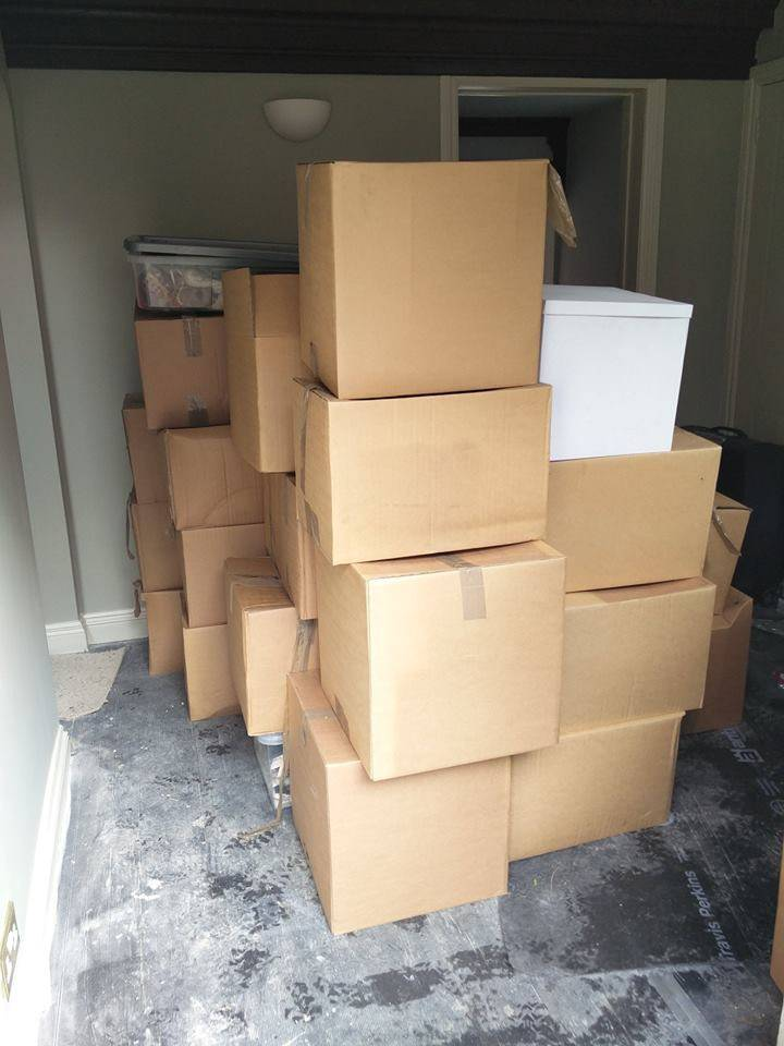 Customers belongings all packed up and organised into lots of cardboard boxes.